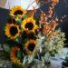 vase-with-sunflowers-orange-ilex-berry-willow-magnolia-foliage-and-seeded-eucalyptus-6000